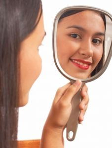 women-looking-in-mirror